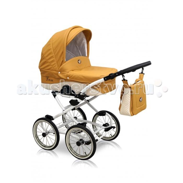 Коляска Nastella Luxe 3 в 1 EcoLuxe 3 в 1 EcoДетская коляска 3 в 1 Nastella Luxe – великолепная и неповторимая модель! Стильный дизайн не оставит равнодушным даже самых привередливых родителей. Высокая проходимость по бездорожью благодаря большим надувным колесам. Плавность хода обеспечивает мягкая подвеска.  Прогулочный блок: Максимально допустимая весовая нагрузка - 18 кг Спинка блока регулируемая, имеет угол наклона комфортный для сна и отдыха ребенка Регулируемая подножка Мягкие накладки на пятиточечных ремнях безопасности Мягкий бампер безопасности (перекладина перед ребенком)  Люлька: Механизм легкой установки на шасси Большой, складываемый капюшон Высокие непродуваемые борта Жесткое дно Верхний чехол на надежных застежках Высококачественный материал внутренней и внешней обивки  Автокресло: Автомобильное сидение группы 0+ от польского бренда Nastella рассчитано на деток с рождения и до момента, когда их вес достигает 13кг Кресло снабжено удобной ручкой для переноски и защитным капюшоном Nastella Luxe автокресло имеет свои ремни безопасности  Шасси: Механизм сложения - книжкой Большие, надувные колеса Мягкая амортизация Металлическая сетка для покупок Регулируемая под рост родителей ручка Возможность установки на шасси детского автокресла  Размеры и вес: Прогулочный блок: Глубина сидения: 20 см Длина спального места: 92 см Ширина сидения: 35 см   Люлька: Ширина: 38 см Глубина люльки: 23 см Длина: 81 см   Ширина колесной базы: 61 см   В комплекте: Шасси Люлька Прогулочный блок Автокресло Сумка для мамы  Вес: 12.5 кг.<br>