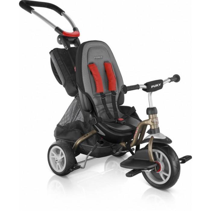 Велосипед трехколесный Puky CAT S6 CeetyCAT S6 CeetyPuky CAT S6 Ceety - самый продвинутый и престижный велосипед для малышей от 1 до 4 лет с родительской ручкой. Велосипед изготовлен в Германии из комплектующих европейских производителей. Стиль, качество и функциональность Puky CAT S6 Ceety не имеют аналогов на российском рынке.  Цвет универсальный, подходит как мальчику, так и девочке.  Родительская ручка очень эргономична, она регулируется по высоте и углу наклона. Ручка не вращается и не соединена с поворотным механизмом переднего колеса. Несмотря на это поворачивать велосипед очень удобно, поскольку ручка имеет большую длину и образует большой рычаг. Субъективно управляться с CAT S6 Ceety удобнее, чем с классическим трехколесником с вращающейся ручкой. После того, как ребенок почувствует себя уверенно за рулем и начнет кататься сам, родительская ручка может быть отсоединена.  Сиденье с высокой спинкой и пятиточечным ремнем безопасности больше походит на сиденье престижного автомобиля. Спинка сиденья также может быть отсоединена. Сиденье перемещается вдоль рамы на 6,5 см, можно найти положение, оптимальное для ребенка.  Переднее колесо может жестко сцепляться с педалями, либо свободно вращаться независимо от них. На педали можно установить подставку для ножек (входит в комплект поставки). Руль имеет ограничение угла поворота, кроме того может быть зафиксирован в положении вперед, это удобно при катании при помощи родительской ручки. Есть тормоз задних колес в виде ручки, управляемый ребенком. Для того, чтобы остановиться ребенку достаточно потянуть ручку на себя.  Модель идеальна для шопинга - под сиденьем расположен объемный кузов с сеткой для продуктов. На родительской ручке располагается стильная сумка для более мелких вещей (кошелек, салфетки, баночка сока для ребенка и т.п.). Велосипед легко собирается для перевозки в багажнике легковой машины.  Puky CAT S6 Ceety обладает бесшумным и мягким ходом, шины колес изготовлены из ПВХ. Широкая колесная база обеспечи