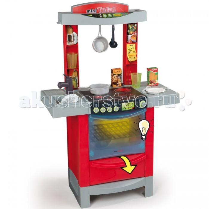 Smoby Кухня Tefal Cook TronicКухня Tefal Cook TronicЭлектронная игрушечная кухня Tefal Cook Tronic со световыми и звуковыми эффектами для сюжетно-ролевых игр детей в возрасте от 3 лет.  Кухня оснащена варочной панелью на 2 конфорки (газовая и электрическая), духовкой с открывающейся дверкой и подсветкой, раковиной с краном, разделочным столиком и полочками для хранения продуктов или посуды.  В наборе с кухней также есть 16 аксессуаров: 2 тарелки, 2 вилки, 2 ложки, 2 ножа, половник, 2 стакана, ковшик, сотейник, 3 упаковки с продуктами (не русифицированы).  При нажатии на кнопки включения конфорок загорается соответствующий индикатор, раздаются звуки приготовления пищи. Духовка открывается, открывается дверца внизу духовки. При открывании дверцы духовки загорается подсветка в духовке.  Тематические игровые наборы способствуют социальной адаптации ребенка, приобретению навыков, помимо того, что просто развлекают и доставляют массу удовольствия.<br>