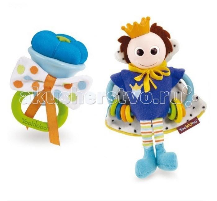 Погремушка Yookidoo Принцесса и ПринцПринцесса и ПринцПогремушки Принцесса и Принц Yookidoo пластиковая голова и корона, ручки, на которые одето по несколько цветных колечек, мантия с шуршащим наполнителем. Мантия из ткани разной фактуры, на атласной завязочке. Забавные мягкие ножки. Есть петелька для подвешивания. Цветочек с колечком для держания из мягкого пластика, которое можно использовать как прорезыватель для чешущихся десен и режущихся зубиков малыша. Бантик из атласной ткани с шуршащим наполнителем.  Сам цветочек мягконабивной в пластиковой обертке. Погремушки с разным звучанием. Погремушка великолепно развивает работу кисти и укрепляет мускулатуру рук. Мягкий материал и мелкие детали способствуют развитию мелкой моторики пальчиков рук и тактильных ощущений малыша.<br>