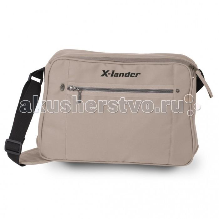 X-Lander Сумка для коляски OutdoorСумка для коляски OutdoorСумка для коляски Outdoor выполнена в современном стиле  благодаря дополнительным застежкам на ремешке, сумка с легкостью крепится на коляску ремешок сумки имеет мягкий наплечник, и даже в наполненном состоянии, Вы не будет ощущать дискомфорта в плече в сумке имеется термосумка для бутылочки, кошелек на ремешке, и мягкий пеленальный матрасик по периметру сумки проходит молни, расстегнув которую можно в несколько раз увеличит вместительность сумки, и Вы сможете взять на прогулку все самое необходимое в сумке есть два открытых отделения, и одно отделение на молнии подходит ко всем коляскам фирмы X-Lander<br>