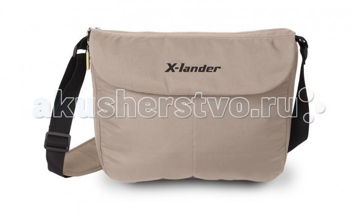 X-Lander Сумка для коляски UrbanСумка для коляски UrbanСумка для коляски Urban выполнена в современном стиле  благодаря дополнительным застежкам на ремешке, сумка с легкостью крепится на коляску ремешок сумки имеет мягкий наплечник, и даже в наполненном состоянии, Вы не будет ощущать дискомфорта в плече в сумке имеется термосумка для бутылочки, кошелек на ремешке, и мягкий пеленальный матрасик по периметру сумки проходит молни, расстегнув которую можно в несколько раз увеличит вместительность сумки, и Вы сможете взять на прогулку все самое необходимое в сумке есть два открытых отделения, и одно отделение на молнии подходит ко всем коляскам фирмы X-Lander<br>
