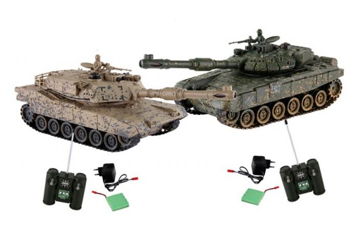 Yako Танковый бой М1А2 Абрамс против ТиграТанковый бой М1А2 Абрамс против ТиграТанковый бой YAKO М1А2 Абрамс против Тигра  В качестве снарядов танки выстреливают инфракрасными лучами на расстояние до 3 м. При выстреле происходит звуковая соответствующая имитация. У каждого танка, на задней стороне башни есть 4 светодиода - жизни машины.   Цель игры - уничтожить танк неприятеля. При попадании по танку его жизни уменьшаются - потухает светодиод, если все светодиоды потухли, значит Вы проиграли и танк больше не сможет исполнять Ваши сигналы. Так же следует отметить, что два танка имеют различные характеристики, но в целом силы равны.   Особенности:   Частота 27 МГц (А/С)  В наборе 2 танка 1:24.   Пушка с инфракрасным излучаетелем.   Индикатор уровня жизни.   Радиус действия пульта - 12 м.   Радиус передачи ИК сигнала - 8 м.   Время работы 15-20 минут.   Время зарядки - 4 часа.   Скорость танка - 6 км/ч.    Демо режим.   Функция автоотключения.   Имитация отката при выстреле.   Движение танка во все стороны.   Поворот башни на 320 градусов. Подъём на наклонную поверхность при угле наклона - до 45 градусов.   Световые и звуковые эффекты. Звук двигателя и выстрелов.    Питание танка от аккумулятора (в комплекте) Ni Cd 600 mAh 4,8V.   Питание пульта управления - от 2-х батареек типа АА (нет в комплекте).<br>